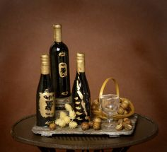This enchanting handmade wintery miniature wine tray is a decorative eyecatcher for every dollhouse or miniature wine cellar.  The tray is made of wood and decorated with a small halved wooden barrel, three different bottles of red wine, a little basket filled with walnuts, a wine glass, dried autumn plants and walnuts.  Each noble bottle has a hand-painted gold-coloured label. All parts on the tray are fixed.    Measurements: 5.0 x 4.8 x 3.5 cm / 1.97 x 1.89 x 1.38 (H x B x D) inches…