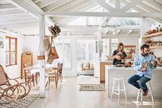 An open plan kitchen - living room in the beautiful home of General Store owner Serena Mitnick-Miller. Photo -  Jason Frank Rothenburg for Domino.