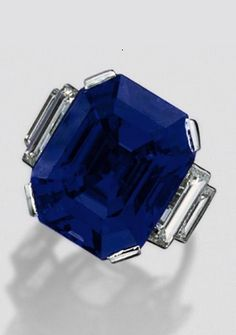An Art Deco sapphire and diamond ring, Mauboussin, Paris, circa 1935. The emerald-cut sapphire weighing 31.45 carats, flanked by 4 baguette diamonds, mounted in platinum, signed Mauboussin, France. #Mauboussin #ArtDeco #ring