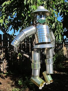 Recycled tin cans into scarecrow.  We made one one year, they really rust.