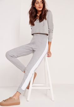 Work some major relaxed vibes in these totally on point grey joggers. With figure flattering low wrap detail waistband, chic white panels running down both sides and elasticated back and ankle finish, these beauts are top of our wishlist.