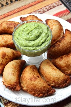 Choriqueso empanadas with avocado sauce. Chorizo + cheese stuffed in an empanada + topped with avocado sauce = heaven!