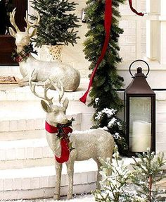 #Christmas #decoration ideas Silver reindeer ToniK Ðℯck Ʈհe HÅĿĿs glass #lanterns Frontgate exterior