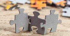 concept of teamwork: three jigsaw puzzle pieces on a table joint together. shallow depth of field Collaborative Divorce, Volunteer Management, Sales Management, Emotional Resilience, Sales Process, Puzzle Pieces, Teamwork, A Table, Portal