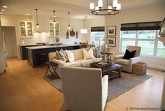 Contemporary Great Room with can lights, Kaleen 4500 renaissance area rug, Chandelier, double-hung window, Crown molding