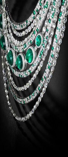 """Close-up of the regal necklace by de Grisogono, adorned by Sharon Stone during Cannes Film Festival. """"...diamonds draping freely ...257 white diamonds with the total weight of 159.87 Cts...The alluring 7 cabochon-cut emeralds weigh 64.86 cts...complemented by 331 small round emeralds totalling 6.11cts. ...2188 white diamonds that come up to 43.82 cts…is rare that diamonds are drilled through to be connected with each other by a simple gold hoop…"""""""