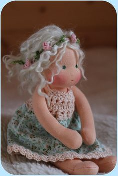 Let me introduce you Eloïse , this sweet dreamy girl with white hair , and green eyes .  She is completely hand made and hand sewn doll Waldorf