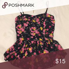 Super cute floral peplum tank top! This top is extra cute! It's floral, has a peplum for a flattering fit. The breast area is padded so no need to worry about a bra! Silky material and never needed to iron. Has plenty of life left. If I still had my pre-pregnancy bod I would be in it right now. Tops Tank Tops