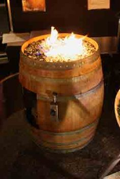 You have the colored glass inside that changes color with the flame. fire Convert a wine barrel into a safe outdoor firepit. Rustic Garden Decor, Rustic Gardens, Outdoor Projects, Outdoor Ideas, Backyard Ideas, Outdoor Spaces, Glass Fire Pit, Fire Pits, Wine Barrel Furniture