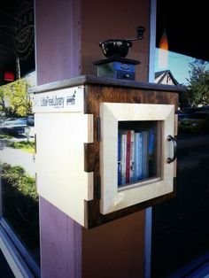 chART Public Art Marpole. Vancouver, British Columbia, Canada.  	 This little free library was designed by chART in collaboration with Bean Around the World. This unique sculpture/library is registered officially as part of the international movement at littlefreelibrary.org. The seed books, which are all on the theme of travel, were donated by Characters Book Store, a Marpole business that closed in 2012.