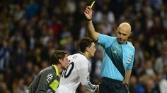 Referee Howard Webb shows a yellow card to goalkeeper Roman Weidenfeller : Webb did well except for ignoring Ramos's elbow in Lew's face all night.