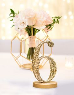 Make Your Table Numbers Visible... and Cute! Gold glitter table numbers for your wedding that won't cost a forstune. // Handcrafted Table Numbers and Event Decor, Gifts & Accessories at www.ZCreateDesign.com or ZCreateDesign on Etsy