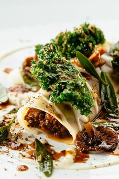 This stunning venison cannelloni recipe is a wintry sight to behold. Paul Welburn playfully evokes the flavours of a traditional cannelloni with a rich Parmesan sauce, while the intense braised venison is flavoured with juniper for a heady flavour. Fried Mushrooms, Stuffed Mushrooms, Cannelloni Recipes, Great British Chefs, Parmesan Sauce, Pasta Machine, Vegetable Puree, Kale, Gourmet