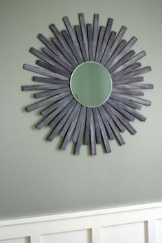 DIY sunburst mirror using paint sticks