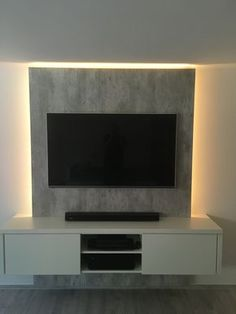 TV wall in a successful combination: trendy concrete look and matt vanilla-TV-Wand in gelungener Kombination: Angesagte Betonoptik und Vanille matt Successful combination: trendy concrete look and vanilla … - Tv Wand Modern, Tv Wanddekor, Tv In Bathroom, Bathrooms, Modern Tv Wall Units, Living Room Tv Unit Designs, Tv Wall Decor, Wall Tv, Tv Furniture