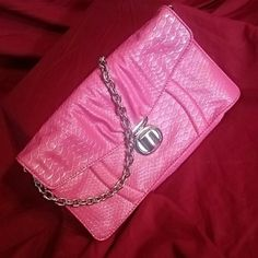 pink kathy handbag Super cute snake skin print with silver accents has inside Zipp pocket and  built it credit card slots with a silver chain strap Kath Bags Shoulder Bags