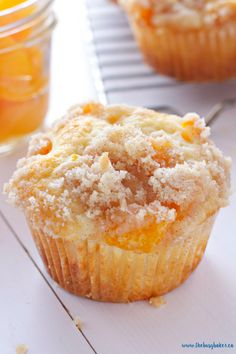 These Peach Cobbler Muffins are the perfect sweet snack! This is such an easy recipe that taste's just like Grandma's peach cobbler! And the best part? They're even easier to make than a traditional cobbler and have the perfect crumble topping! Recipe from thebusybaker.ca! #peachcobbler #peachcobblermuffins #peachmuffins