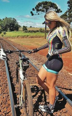 Girls are beautiful on bikes.and this lady looking sexy in Lycra bike shorts also appears to be signalling that the am train service to Sydney is coming round the corner too. Women's Cycling, Cycling Girls, Cycling Wear, Cycling Outfit, Cycle Chic, Bicycle Women, Bicycle Girl, Triathlon, Sporty Girls