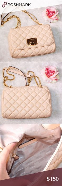 Michael Kors bag I'm reselling this item purchased here on Posh. It's a beautiful peachy pink Michael Kors bag w convertible strap that can be worn shoulder length or cross body. Michael Kors Bags Crossbody Bags