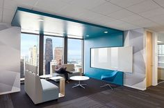 Interesting use of slight soffit and color to define space. The white board is a nice touch. IA Interior Architects