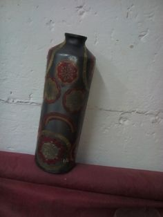 decoupaged metal sports bottle that lost its lid. What could it become?