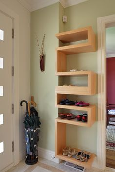 Look for wall-mounted shelving that will keep your stuff stylishly out of the way.