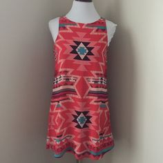 EUC Pink Aztec Print Dress So Cute! Excellent used condition! Only worn one time. Pink Aztec Print Dress with cream, teal and purple colors.  This dress is so cute and comfy, makes a perfect spring and summer dress!  The dress is chiffon material and does have lining. Shell 100% polyester lining 100% polyester. Xhilaration Dresses