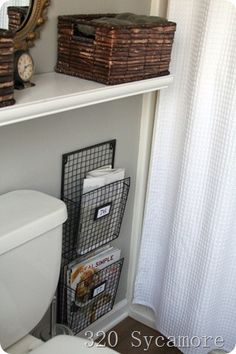 Free up bathroom floor space by mounting the magazine holder next to the toilet. Looks great too.
