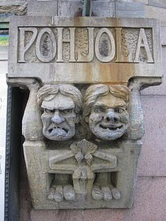 Two stone trolls embedded in a Helsinki building. Pohjola is a location in Finnish mythology, sometimes translated as Northland, one of the 2 main polarities in The Kalevala.