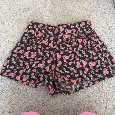 Floral shorts Floral shorts with elastic band. NWOT 100% polyester Charlotte Russe Shorts