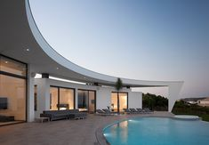 Curved Wall Architecture Framing Outstanding Views.  Designed by Portuguese Architect Mario Martins.