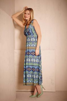 Add a splash of colour to your wardrobe with a statement dress. Keep your summer look elegant and sophisticated and pick a longer length like this maxi dress. #fashion #styletips #timelessfashion