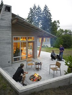 Really like the concrete bench for a ton of seating around the concrete firepit