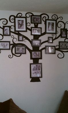 Paint a tree on the wall, spray paint any frames you have and print pictures in black and white. Very cool family tree!!