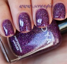Zoya Aurora. Aurora is one of the three new holographic colors and out of the three, Aurora seems to have the densest amount of holographic glitter.