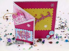 Kelly Patricia - 8x8 card with pocket & Tree Decoration - Christmas Classiques Only Words 'Merry and Bright' die - Christmas Classiques 'Santa's Sleigh' die - Essentials: Scallop Circle dies - Essentials: Scallop Rectangle die - Pink Card Core'dinations - Centura Pearl Card - Spray & Sparkle silver - #crafterscompanion #Christmas