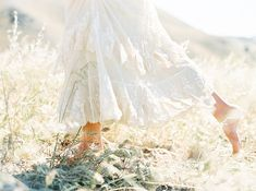 Lilac Wedding Flower Inspiration - Once Wed - - A woman running through a field in a white dress. Lilac Wedding Flowers, Running Women, Woman Running, Once Wed, Wedding Flower Inspiration, Felder, White Aesthetic, Perfume, Bridal Portraits