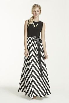 Stand out at any special occasion in this gorgeous dress with long print skirt!  Sleeveless knit top bodice with ribbon tie waist creates a flattering silhouette.  Dramatic long charmeuse skirt features eye-catching print detail.  Fully lined. Back Zip. Imported polyester. Dry clean only.