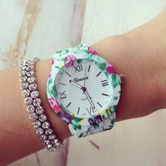 Bold blooms in a range of vibrant colored floral print watch. A beautiful…