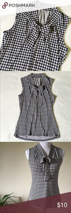 Black & White Houndstooth Pussy Bow Top Black & White Houndstooth Pussy Bow Top  Black and white pussy now stretchy blouse. Super cute minimal high low hem. Soft poly stretch material. NO TAGS priced accordingly. Dress Form 34 x 27 x 35 PERFECT CONDITION Tops