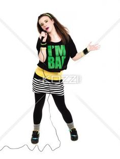 young woman with microphone. - Young woman with microphone over white background. Model: Megan Butt