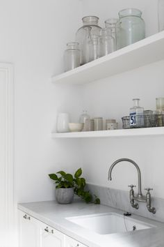 The owner also wanted somewhere to arrange flowers from the garden and the honed Carrara marble bench is the ideal platform. Displayed on shelves in Dulux Natural White, vases double as decoration items. Dulux Natural White, Dulux White, Laundry Design, Australian Homes, Mudroom, Decorative Items, Floating Shelves, New Homes, Home And Garden