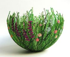 Free embroidered bowl made using dissolvable fabric.