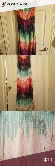 """Trixxi Tie-dye Boho Belted Maxi Dress Tie-dye boho style belted maxi dress in size Large by Trixxi. This dress has only been worn twice. I somehow managed to snag it on something the last time I wore it. I have attached a picture of the snag located near the middle of dress. It is not noticeable when worn and could be fixed but I'm not a seamstress. Still has lots of life left. I am 5'7"""" tall and it hits right at my ankles. This dress has been in storage for the last year. Trixxi Dresses…"""