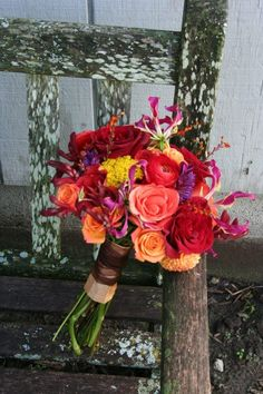 Bright summery bouquet with bench background