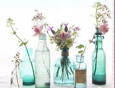 Mix and match blue and clear bud vases