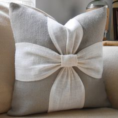 A soothing color palette of grey and off white burlap are combined to make this beautiful bow pillow cover. This pillow cover can be ordered in the reverse color scheme with a grey background and a white bow. You can also order this pillow in all the same color for a grey on grey or