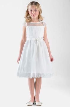 Free shipping and returns on Us Angels Point d'Esprit Dress (Big Girls) at Nordstrom.com. A gauzy point d'esprit overlay furthers the dreamy charm of a darling cap-sleeve dress topped with an illusion neckline that softly frames her face. The removable grosgrain-ribbon belt cinches the full-skirted silhouette while adding a girly finishing touch.