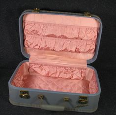 Vintage Lady Baltimore luggage.  I had one just like this.  An 8th grade graduation present.