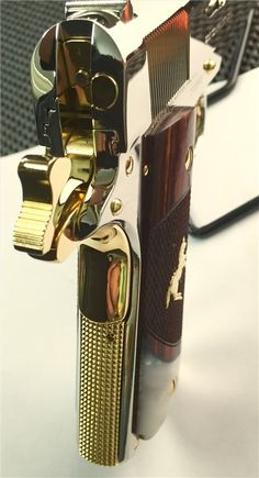 Colt 1911 A Government Model that was hand polished then nickel plated, and finally having it's minor accent parts gold plated. Not a factory offered limited edition variant, but instead of being chambered in the classic .45 ACP, the one in the photos is a .38 Super. The caliber is mostly seen in competition guns because of its popularity among the IPSC and similar crowds. .38 Super is also used in countries where military calibers like the .45 ACP are not allowed for civilian use. (GRH)